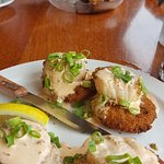 Seared scallops atop fried green tomatoes