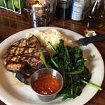 Entree: Grilled Pork Chop with Mashed Potatoes and Spinach.