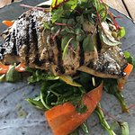 Local grilled pompano fish - perfect cooked and paired with a tangy passionfruit vinaigrette and