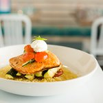 Seared Salmon: Light and fresh North Atlantic salmon on a bed of couscous and zucchini, roasted red peppers, topped with tomato-cucumber salad and creme fraiche.