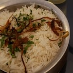 Dishes come with a light rice.  Long grain Basmati.