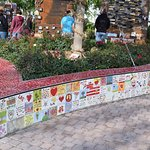 Beautiful heart shaped raised garden adorned with tiles made by victim's families, survivors, and community members. It also includes the Tree of Life.