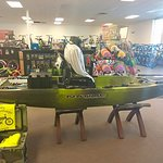 This just about sums up our store in a single photo. Discs, Kayaks, Historic T-shirt, and a bevy of bikes.