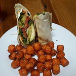 Veggie wrap with sweet potato tots.