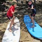 Practicing how to stand on the surf board before getting into the sea
