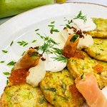 Zucchini pancakes with salted salmon and smoked sour cream