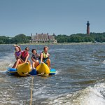 Banana and Tubing Rides- Our tow boat can accommodate 12 passengers. Come to North Beach Watersports and experience the thrill of riding the banana or tube or simply observe and enjoy the boat ride. Your Tubing or banana excursion will be in the Northern Currituck Sound, in front of the Historic Currituck Lighthouse and Whalehead Club.