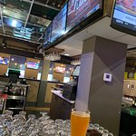sitting at bar showing all the televisions.