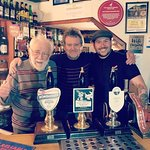 Three generations of landlords behind the bar at the Childers