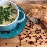 Chikhirtma is a delicious chicken soup from  Georgia. It is a nice blend of chicken broth, vinegar, eggs, spices and greens. The soup has a slightly sour taste and a cream-like consistency.