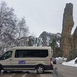One of our very nice 9-14 passenger vans on the Needles Highway by one of the spires, totem pole rock.