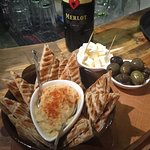 Our signature plate: Hummus & Pita, local olives and white cheese. Great small dish to accompany with wine
