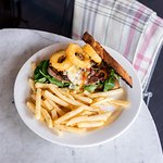 The Mayfair steak sandwich, Stirling Ranges scotch fillet cooked medium, mushroom ragu, 3 cheese sauce, crispy onion rings, sourdough