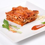 Bolognese Lasagna made with classic bolognese souce and original parmigiano.