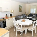 Summer Lodge 21 is wheelchair accessible with a large wheel-in wet room. Sleeps up to 4 adults. Surrounded by open park gardens and a short stroll to Eype Beach, lovely for swimming in the sea and pet friendly all year round.