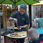 Tableside guac being prepared. Our waiter asked the kids to watch so they could make it for me a