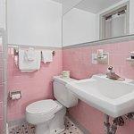 Single room bathroom with shower only. 3rd floor. Purple. Ben Franklin.