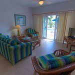 Two Bedroom Poolside can accommodate up to 6 persons. King sized bedding in one room and two twin sized beds in other room each room has their own bathroom. Living room has pull-out sofa.