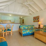 One Bedroom Deluxe Oceanfront. These units can accommodate up to four persons. Living room has two twin sized say beds. Fully air-conditioned and located right on the beach.