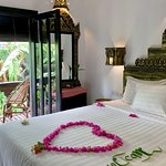 beautiful king bed room  with pool view at petit temple suite hotel