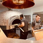 & The wood burning Pizza Oven - produces brilliant pizzas