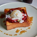 Pain Perdu French toast. Pan roasted strawberries, vanilla ice cream, maple syrup