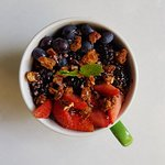 Acai Power Bowl(VE/V)(DF)(N) Acai, wild berries, banana, homemade honey pecan, coconut granola and cacao nibs