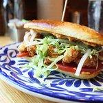 Shrimp Po Boy Roll - Cajun 1000 island, lettuce, pickled veggies, pain au lait