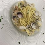Spaghetti with freshly caught local clams drizzled with parsley