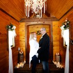 Picture yourself here,under the chandelier! Our Little Log Wedding Chapel is cozy, charming and intimate, open year round