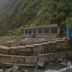 Panoramic view of all the pools from the other side of the river where the rooms are.
