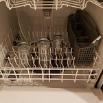 Dirty dishes still in dishwasher from previous stay.
