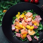 Mediterranean salad mix with mango, avocado, grapefruit, orange, citrus sauce and tuna