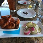 FRENCH WINGS - crispy frog legs in spicy (BBQ) sauce with cumber salad.