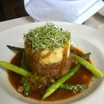 Lamb shepherd's pie with onion and cognac sauce and asparagus.