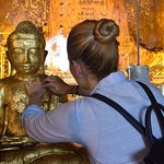 Our guest from Switzerland is applying gold leaf to the Buddha Image. It's such a long tradition in Myanmar since Queen Shinsawpu's period who donated 40 kilos of her own body weights to the Shwedagon Pagoda during her trip from Bago to Yangon. To get to know our culture, Buddhist's tradition, we let our clients to donate gold leaf to Buddha Image.