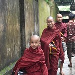 Young novices are going around for alms in Yangon in one morning. They are following Buddha's sermon and do it everyday to go out of their monastery to get foods.
