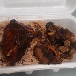 Jamaican Mi Crazy Chicken with Ox-Tails and dirty rice