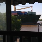View from table of passing cargo ship.