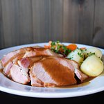 Smoked pork loins served with sauerkraut, carrots, brown gravy and potatoes.