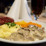 Veal of reindeer served in a tasty game sauce, vegetables, mashed potatoes and lingonberries.