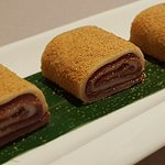 Sweet pinwheels filled with azuki bean paste and coated with peanut dust