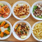 Grilled king prawns, freid squid, octopus salad, crab claws, grilled squid, chips