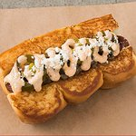 OLD TOWN – smoked bacon wrapped dog, caramelized onions, chipotle aioli, pickled jalapeños, cotija cheese