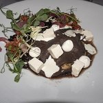 Duck confit enfrijolades - cabbage, pickled onions, queso fresco, goat cheese crema, cumin-chipo