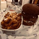 Beef Burger on Pumpernickel bun. Poutine.