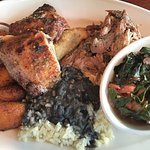 Taste of Jamacia- Plantains, Beef Empanada, Jerk Pork and Chicken, Rice & Beans. Bland-collard g