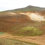 Smaller crater on the left, sulfurous geothermal activity on the right