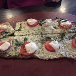 Tired-looking $11.50 flatbread pizza
