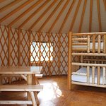 Yurt take and double queen bed.